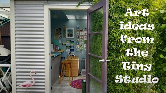 A small art studio with an open door