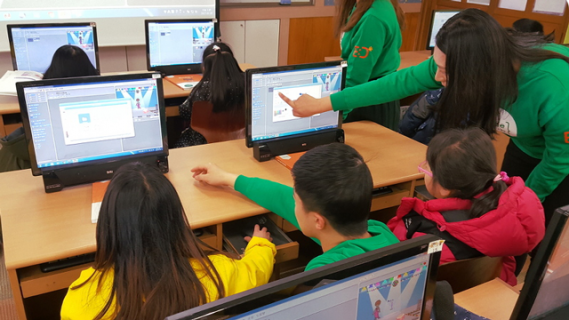Students using laptops to learn coding