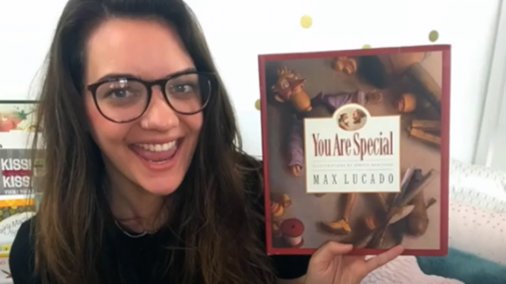 Ashleigh Best holding up a book called 'You are special'
