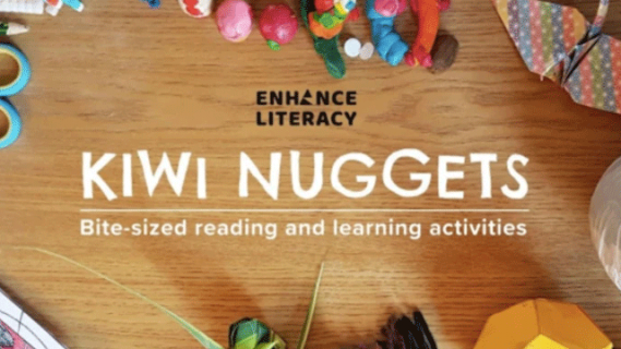 "Photograph taken from above of a wooden table with various craft materials on it. The photograph is overlaid with white text reading""Kiwi Nuggets. Bite-sized reading and learning activities""."