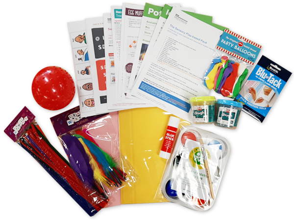 Photograph of arts and craft materials, sheets of paper with instructions, stationery and a textured red rubber ball.