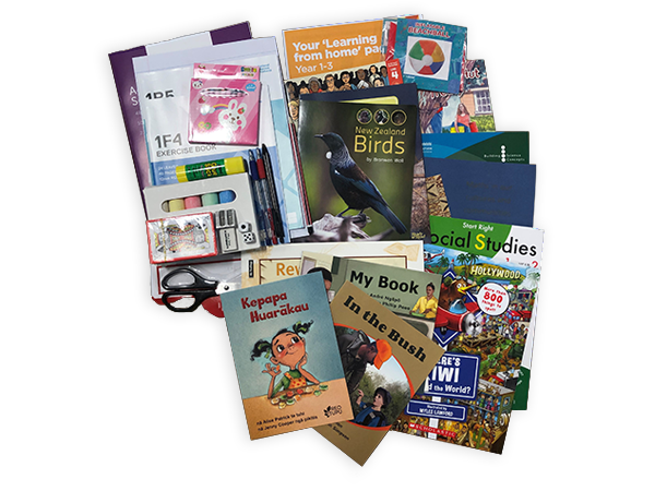 Photograph taken from above of the Year 1 hard pack. The pack contains various picture books, workbooks, exercise books and stationery.