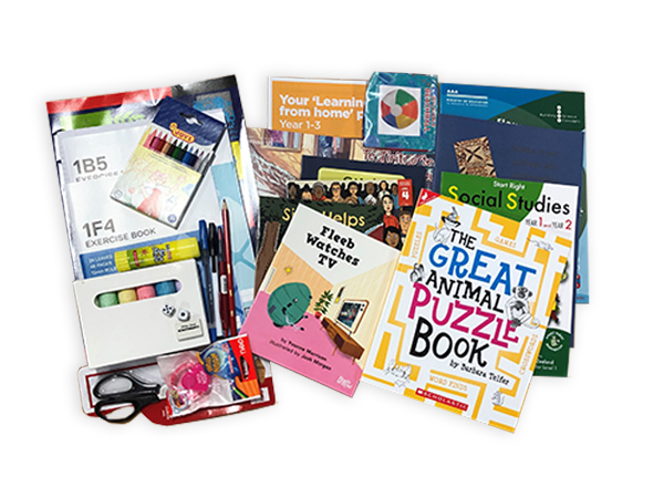 Photograph taken from above of the Year 2 hard pack. The pack contains various picture books, workbooks, exercise books and stationery.