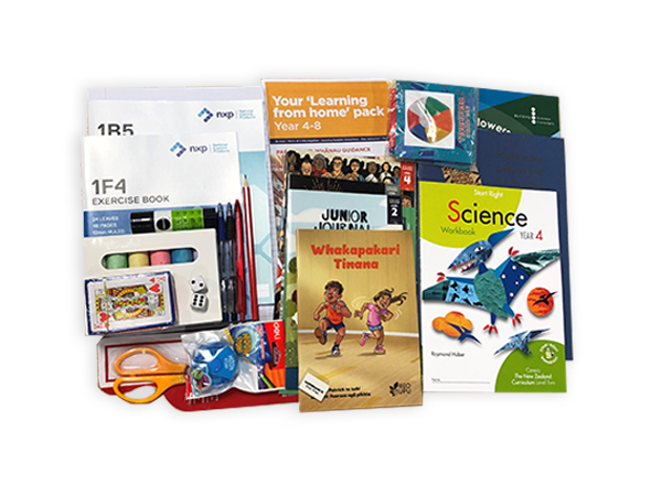 Photograph taken from above of the Year 4 hard pack. The pack contains various workbooks, exercise books and stationery.